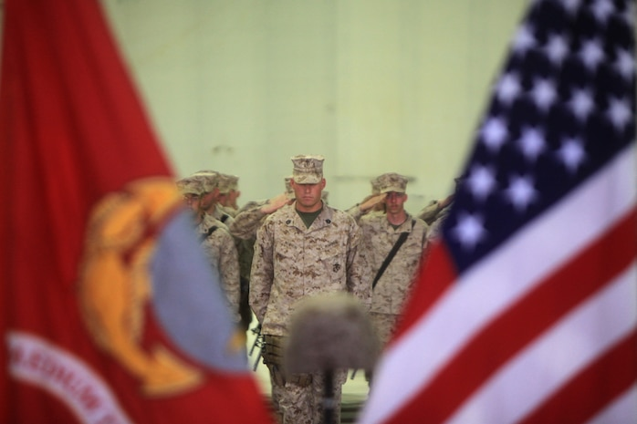 Marines salute during the playing of the national anthem during a memorial ceremony, Sept. 20. During the ceremony, Marines paid tribute to Sgt. Bradley Atwell, an aircraft electrical, instrument and flight control systems technician with Marine Aviation Logistics Squadron 16, from Kokomo, Ind. Atwell was killed in action while engaging insurgents during an attack on Camp Bastion, Sept. 14.