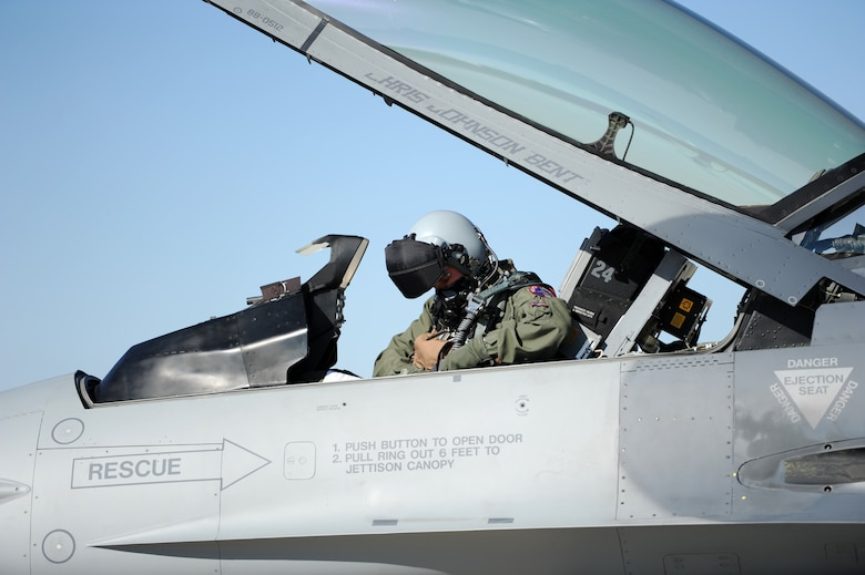 Capt. Dell Schledewitz, South Dakota Air National Guard's 175th Fighter Squadron F-16 pilot, adjusts his safety harness prior to a mission at Ellsworth Air Force Base, S.D., Sept. 18, 2012. The F-16 is a compact, multi-role fighter aircraft that is highly maneuverable and has proven itself in air-to-air combat and air-to-surface operations. (U.S. Air Force photo by Airman 1st Class Hrair H. Palyan/Released)