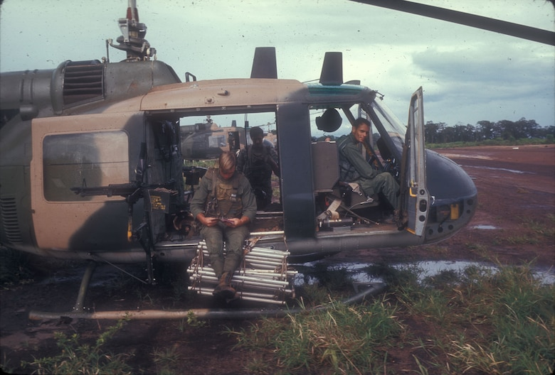 A UH-1 crew armed and ready for a covert mission. Notice the flexible ladder that could be extended to pick up personnel when the helicopter could not land. (U.S. Air Force photo)