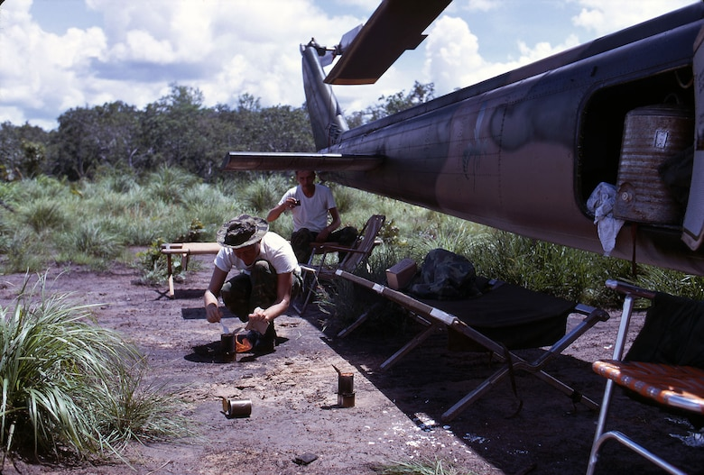 The crew of a 20th Special Operations Squadron UH-1 crew on alert at Thieu Atar, a forward operating location near the border of Laos. When a call came, they quickly put their cots, folding chairs and other items back into the baggage compartment. (U.S. Air Force photo)
