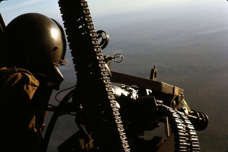 A UH-1 gunner manning a GAU-2 minigun that fired 7.62mm ammunition. (U.S. Air Force photo)