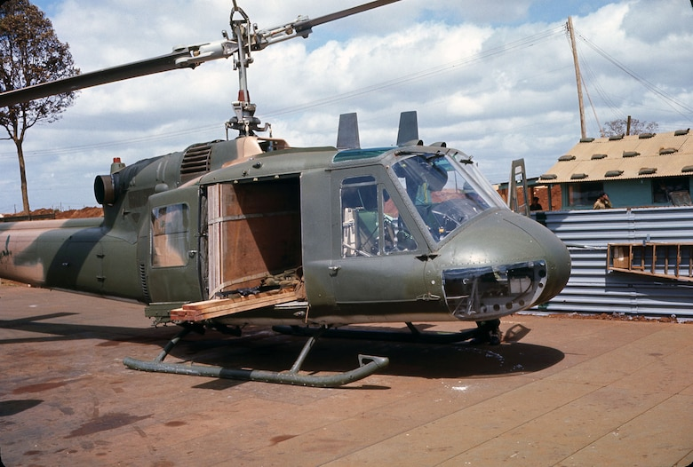 Pony Express missions carried just about anything to support the secret missions and radar sites in Laos. This Green Hornet UH-1 at the forward operation location at Duc Lap, South Vietnam, is hauling lumber and plywood sheets. (U.S. Air Force photo)