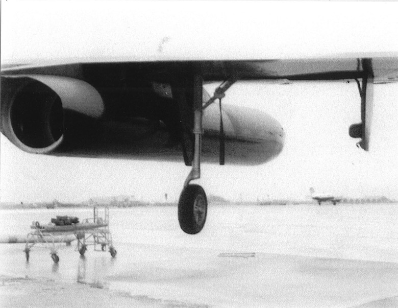 Photograph taken at Da Nang Air Base in South Vietnam showing the damage done to the B-52's left drop tank. (U.S. Air Force photo)