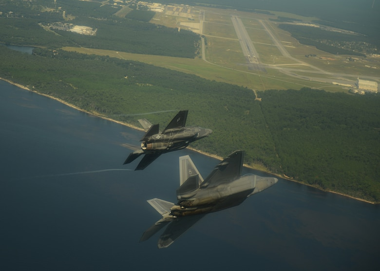 An F-22A Raptor, foreground, from the 43rd Fighter Squadron at Tyndall Air Force Base, Fla., and an F-35A Lightning II joint strike fighter from the 33rd Fighter Wing at Eglin Air Force Base, Fla., soar over the Emerald Coast Sept. 19, 2012. This was the first time the two fifth-generation fighters have flown together for the Air Force. (U.S. Air Force photo/Master Sgt. Jeremy T. Lock)