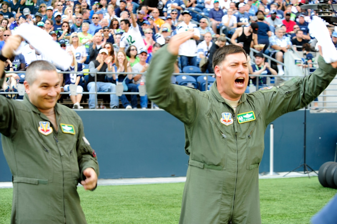Lt. Col. Drew Gonzalez, 159th Fighter Wing, NAS New Orleans, La., and Col. Pete Stavros, Western Air Defense Sector, McChord Field, Wash., cheer on the Seattle Seahawks Sept. 16.  Gonzalez and Stavros conducted a flyover of the game. More than 30 U.S. Air Force Airmen from the 62nd and 446th Airlift Wings presented the U.S. flag on the field during pregame ceremonies for the Sept. 16, Seattle Seahawks home opener against the Dallas Cowboys at Century Link field in Seattle. This was the first of three opportunities for the two units to work together in support of the Seattle Seahawks for the 2012 National Football League season. (U.S. Air Force photo/Master Sgt. Todd Wivell)