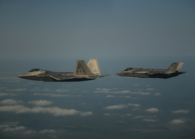 An F-22A Raptor, left, from the 43rd Fighter Squadron at Tyndall Air Force Base, Fla., and an F-35A Lightning II joint strike fighter from the 33rd Fighter Wing at Eglin Air Force Base, Fla., soar over the Emerald Coast Sept. 19, 2012. This was the first time the two fifth-generation fighters have flown together for the Air Force. (U.S. Air Force photo/Master Sgt. Jeremy T. Lock)