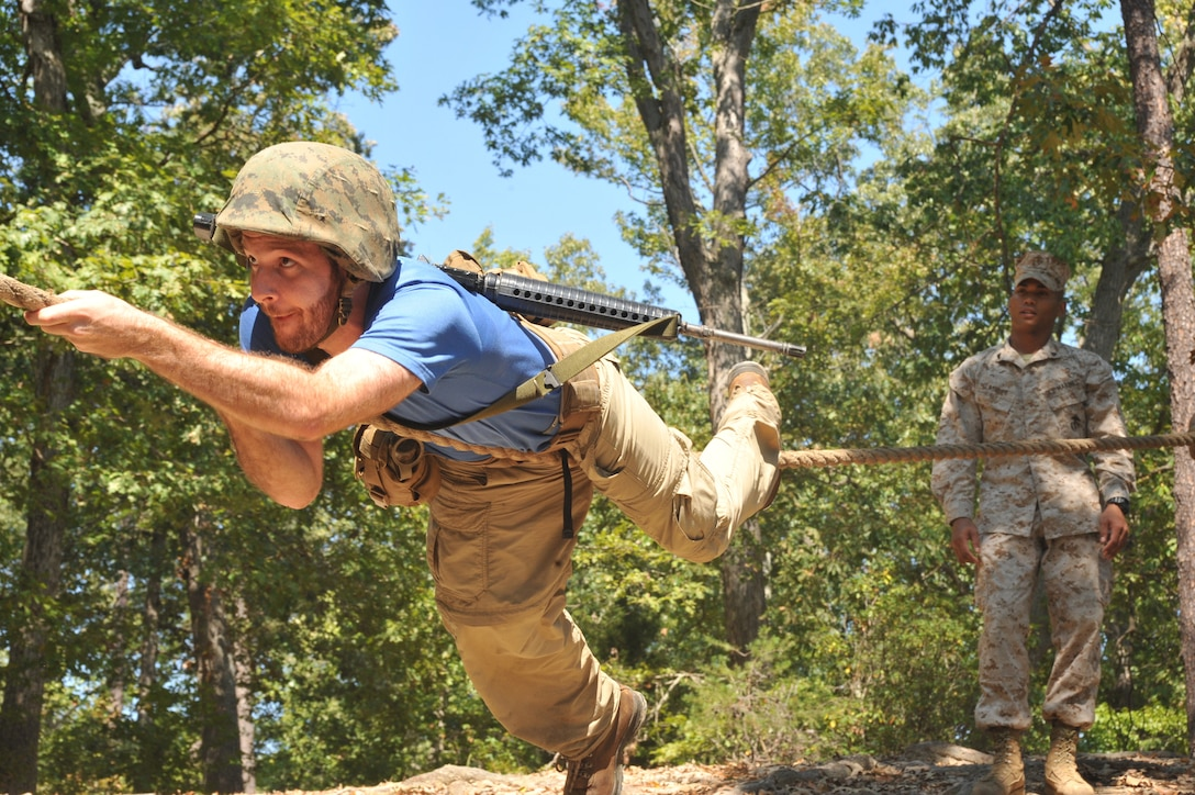 Jacob Cohn, Wharton School University of Pennsylvania graduate student, complete an obstacle from the Officer Candidates School?s combat course during the Quantico Leadership Venture at OCS on Sept. 21. The venture was a two-day event.