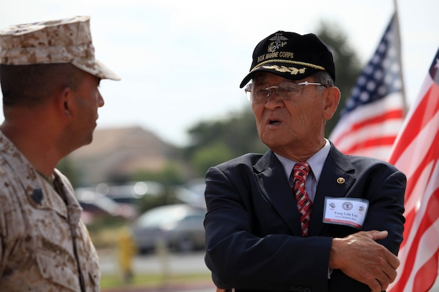 Master Sgt. Ruben Urquidez, the operations and training chief for Marine Corps Base Operations, speaks with Yong Lim Lee, a Republic of Korea?s veteran, at the 62nd Memorial Anniversary of the Korean War at Camp Pendleton?s Pacific Views Event Center, Sept. 22. The event was held to honor the veterans who fought during the Landing on Inchon, in the street of Seoul and in the northern mountains near the Chosen Reservoir.