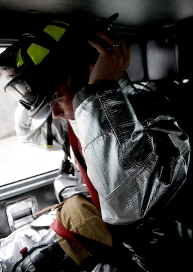 ANDERSEN AIR FORCE BASE, Guam—Airman 1st Class Larry Gish, 36th Civil Engineering Squadron firefighter, dons his personal protective gear in preparation for an in-flight emergency here, Sept. 18. The Andersen Fire Department is trained to respond to a wide variety of scenarios, including but not limited to wild fires, in-flight emergencies, car fires and medical emergencies. (U.S. Air Force photo by Senior Airman Jeffrey Schultze/Released)