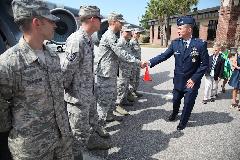 New 315th Airlift Wing commander Col. James Fontanella greets honor guard memembers in front of the mini C-17 Saturday Sept. 22, 2012, after the assumption of command ceremony at Joint Base Charleston, S.C. Fontanella took command of the wing during the ceremony at JB Charleston, S.C. U.S. Air Force photo by Staff Sgt. Rashard Coaxum.