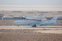 Space Shuttle Endeavour being ferried by a modified 747 aircraft, leaving Edwards AFB, CA. on September 21, 2012.  US Air Force Photo by Christian Turner.