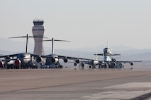"""""""One of these things is not like the other."""" Space Shuttle Endeavor departs Edwards AFB for thefinal time before being flown to it's final destination in a Southern California museum."""