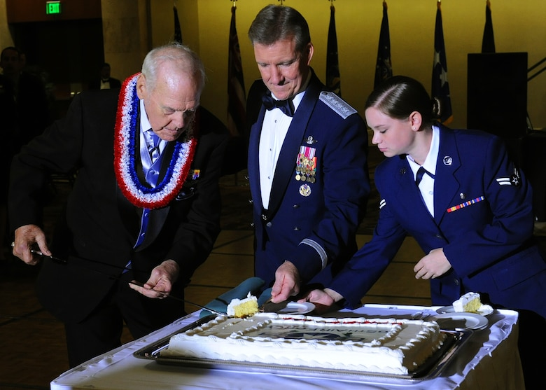 """Durward Swanson cuts a piece of cake with Gen. Herbert """"Hawk"""" Carlisle, Pacific Air Forces commander, and Airman 1st Class Alexandria Wensink, 15th Aerospace Medicine Squadron public health technician, at the Hilton Hawaiian Village Sept. 14, 2012. Swanson, a Hickam Field Survivor of the Dec. 7, 1941, attacks on Oahu, was the guest of honor and participated in the symbolic cake cutting, which involves the youngest and oldest Airmen present cutting the cake. Swanson was a U.S. Army Air Corps motorcycle patrolman at Hickam when the Japanese attacked the bases on the Island of Oahu 70 years ago. Swanson and his best friend, Albert Lloyd, lowered the flag from the flagpole after the attacks. The tattered U.S. flag is now known as Old Glory, and is on display in the Courtyard of Heroes at the PACAF headquarters building. (U.S. Air Force photo/Tech. Sgt. Jerome S. Tayborn)"""