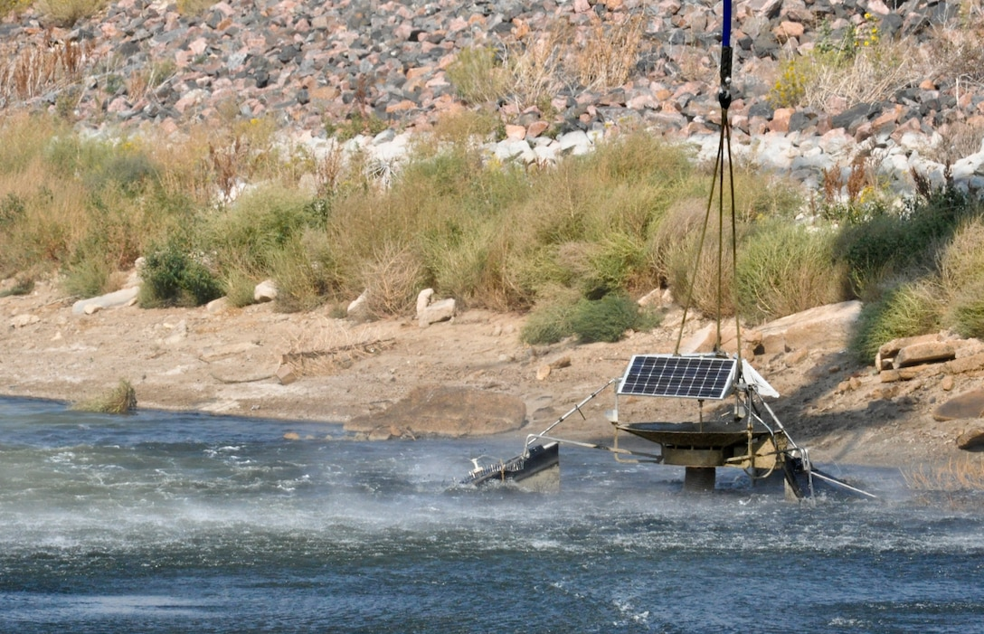 BUCKLEY AIR FORCE BASE, Colo. – A non-functioning aerator was lifted from the shallow waters of Lake Williams Sept. 20, 2012.  The Colorado Army National Guard teamed up with the 460th Civil Engineer Squadron to remove the device from the lake. (U.S. Air Force photo by Staff Sgt. Nicholas Rau)