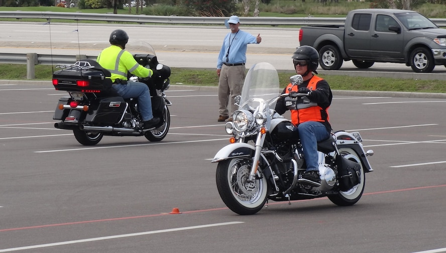 Patrick Air Force Base motorcycle riders take the motorcycle safety course in the commissary parking lot.  The course is required for military members who operate a motorcycle on the base.