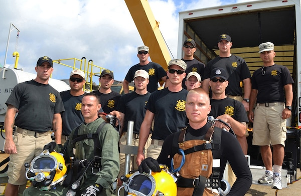 Army divers from the 86th Engineer Dive Detachment at the Army Corps' Marine Terminal Facility at Caven Point, New Jersey.