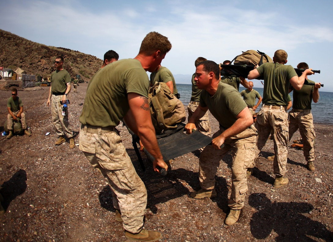 Marines with 1st Platoon, Bravo Company, Battalion Landing Team 1st Battalion, 2nd Marine Regiment, 24th Marine Expeditionary Unit, lift medical stretchers as part of a relay race while competing in the Training Force Challenge in Djibouti, Sep. 16, 2012. The competition was the culminating event of a three-week training package that was focused on the application of infantry skills in rugged mountain terrain. The 24th MEU is deployed with the Iwo Jima Amphibious Ready Group as a theater reserve and crisis response force throughout U.S. Central Command and the Navy's 5th Fleet area of responsibility.