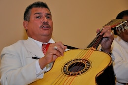 Rafael Sanchez, a guitarist with the Mariachi Real De San Diego mariachi band, sings while playing his instrument the Multi-Cultural Celebration at Camp Pendleton's Pacific Views Event Center, Sept. 18.