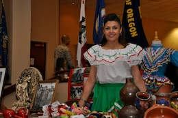 A representative of the Mexican culture stands in front of a Mexico heritage display during the Multi-Cultural Celebration at Camp Pendleton's Pacific Views Event Center, Sept. 18.