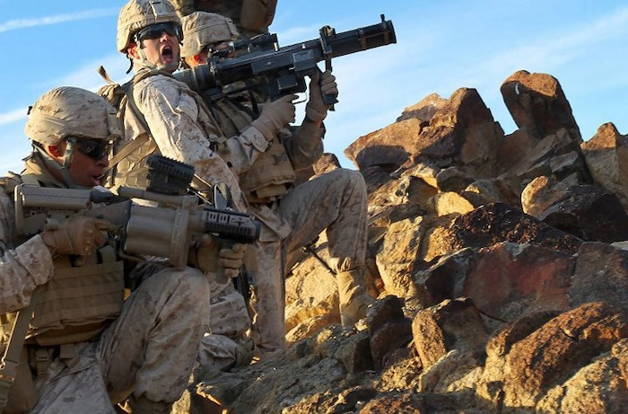 Marines of 2nd platoon, Company B, 1st Battalion, 7th Marine Regiment prepare to shoot the shoulder-launched multipurpose assault weapon on top of machine gun hill during the first round of lane clearing exercises held at Range 410 Jan. 25, 2012.