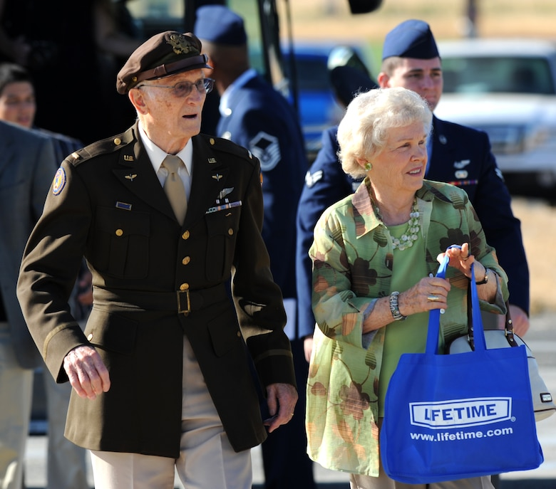 Leonard Kovar and his wife Lorraine are escorted by Airmen to a POW/MIA ceremony at Heritage Park, Beale Air Force Base, Calif., Sept. 21, 2012. Kovar, a POW in 1944 during WWII was the event's guest speaker. (U.S. Air Force photo by Staff Sgt. Robert M. Trujillo/Released)