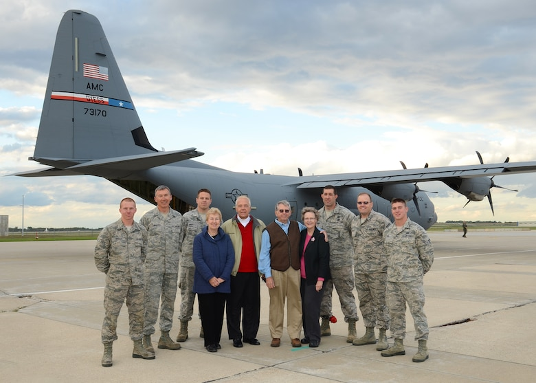 Carol and Bob Dombroski from the Madison Breakfast Rotary in Madison, Wis.(left), and Chuck and Peg MacCarthy with the Good News Project in Wausau, Wis. pose with logistics and travel management specialists of the 115th Fighter Wing in Madison, Wis.  The Wisconsin National Guard Airmen joined forces with the pilots and crew of a C-130J from the 317th Airlift Group, Dias Air Force Base, Texas, to provide transportation of humanitarian supplies and equipment donated by both volunteer organizations. The donated supplies included educational materials for Afghanistan elementary schools, and Medical supplies for clinics in the Commonwealth of Dominica.