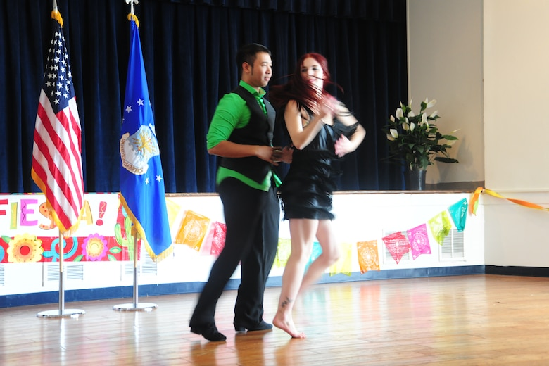Myat Nyunt and Samantha Fries, of Arthur Murray Dance studio, demonstrate salsa, merengue, bachata and rumba dances during a Hispanic-American Heritage Month celebration  at the community activity center, Sept. 21, 2012. The event included a free ethnic-food tasting, a professional dancing demonstration, a live DJ and an opportunity for patrons to dance. (U.S. Air Force photo/ Senior Airman Amber Russell)