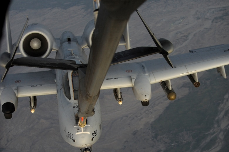 SOUTHWEST ASIA - An A-10 Warthog pulls up behind a KC-10 Extender to be refueled Sept. 18, 2012. The KC-10 is an advanced tanker and cargo aircraft designed to provide increased global mobility for U.S. armed forces. (U.S. Air Force photo/Master Sgt. Scott MacKay)