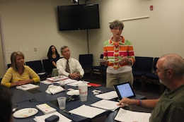 Carolyn Randall, the area manager with Sussex, England, Crime Stoppers, speaks to the Jacksonville Onslow County Crime Stoppers' board during a meeting hosted at Jacksonville City Hall Sept. 20. Randall offered ideas on fundraising events and organization sponsorship.