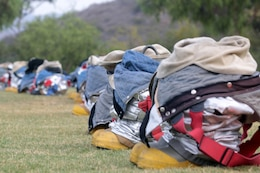Flame and heat resistant bunker gear are lined up waiting for the Marines of Marine Corps Air Station Camp Pendleton, MCAS Yuma and MCAS Miramar during the 2012 Aircraft Rescue Fire Fighting Rodeo at Lake O'Neil aboard Marine Corps Base Camp Pendleton, Calif., Sept. 22.