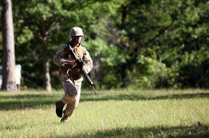A Marine with 8th Engineer Support Battalion, 2nd Marine Logistics Group runs for cover during movement-to-contact training aboard Marine Corps Base Camp Lejeune, N.C., Sept. 25. The purpose of the training was to promote teamwork and combat marksmanship.
