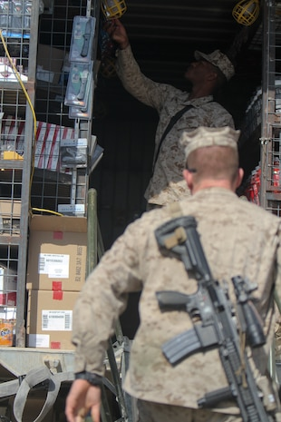 Marines enter the back of a container filled with typical store items, including food, protein, hygiene gear and drinks, Sept. 25. The warfighter exchange service team travels throughout the area, providing Marines with a store every 21 days.