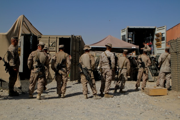 Marines with 1st and 2nd Battalions, 7th Marine Regiment, Regimental Combat Team 6, line up outside a mobile exchange, Sept. 25. The warfighter exchange service team travels throughout the area to provide Marines with hygiene gear, food, drinks, protein and magazines.