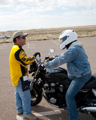 Daniel Salinas, 49th Wing ground safety specialist, instructs a rider on how to properly maneuver the course during the Experienced Rider course at Holloman AFB, N.M., Sept. 25. Over the last six year 458 military members have taken the basic or expert riding course, which has reduced mishaps by 60 percent. In accordance with Air Force Instruction 91-207, riders must take an appropriate motorcycle safety foundation course to ride on and off duty. (U.S. Air Force photo by Airman 1st Class Colin Cates/Released)