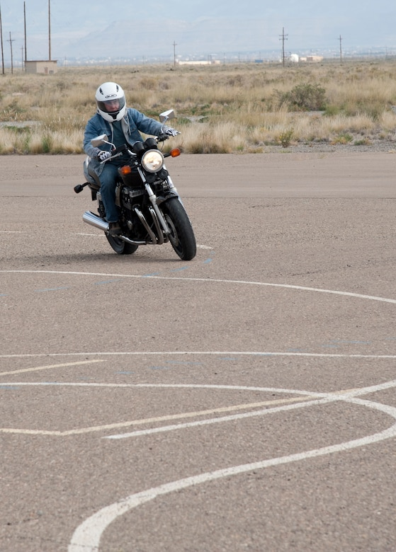 A participant completes a turning drill during the Experienced Rider course at Holloman AFB, N.M., Sept. 25. The beginner and expert classes are designed to help riders of every experience level to become better motorcycle riders. In accordance with Air Force Instruction 91-207, riders must take an appropriate motorcycle safety foundation course to ride on and off duty.  (U.S. Air Force photo by Airman 1st Class Colin Cates/Released)
