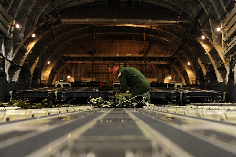Senior Airman Brandon Killen, 437th Operations Support Squadron loadmaster, inspects an extraction package Sept. 24, 2012, at Joint Base Charleston - Air Base, S.C. The 437th OSS provides flying operations support to the 437th and 315th Airlift Wings. They are directly responsible for airfield management, life support services, flight records management, weather and intelligence support, airlift scheduling, tactical employment and aircrew training for approximately 1,400 active duty and Reserve personnel. (U.S. Air Force photo/ Airman 1st Class Chacarra Walker)
