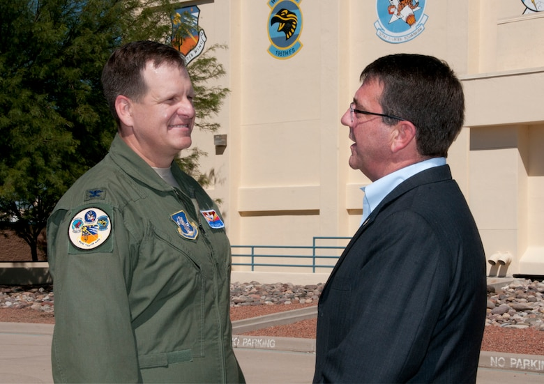 Col. Mick McGuire, 162nd Fighter Wing commander, gives Dr. Ashton Carter, Deputy Defense Secretary, a view of the wing's flightline at Tucson International Airport Sept. 26.  Dr. Carter visited the Arizona Air National Guard's F-16 international training program during a tour of Tucson military installations. (U.S. Air Force photo/MSgt David Neve)