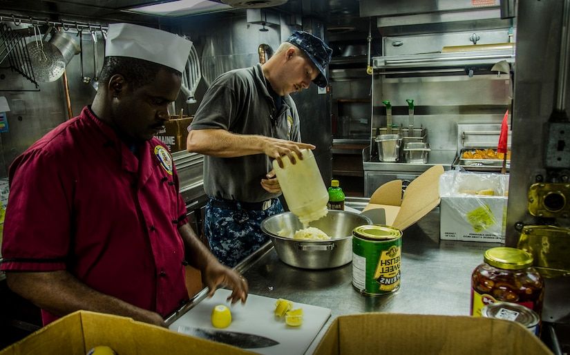 Culinary Specialist 3rd Class Petty Officer Derrick McClendon and Seaman Richard Allen, prepare lunch onboard the USS Nicholas (FFG 47), while the ship was moored pier side, Sept. 24, 2012, during a routine port visit at the Charleston Port Terminal, Charleston, S.C. (U.S. Air Force Photo / Airman 1st Class Tom Brading)