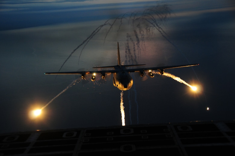 "The 107th Airlift Wing went on another night formation training mission, this time fully loaded with live flares to be used in a training scenario.  A ""Flare"" is an aerial infrared countermeasure to counter and infrared homing (heat seeking) surface-to air or air-to-air missile.Sept. 25, 2012 (U.S. Air Force Photo/Senior Master Sgt. Ray Lloyd)"