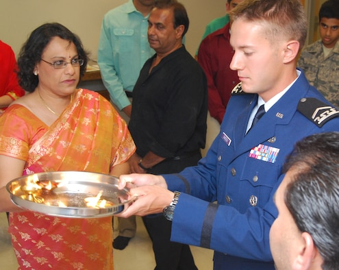 Cadet 2nd Class Ian Sweeney (center) participates in a Sri Ganesh Chaturthi at the Air Force Academy Cadet Chapel Sept. 21, 2012. Sweeney is assigned to Cadet Squadron 18. Also pictured are Mythili Bachu (left), chairperson of the Council of Hindu Temples of North America and president of the United Hindu Jain Temples of Washington, D.C., and Srinivasacharya Gudimella (right), a priest with the Sri Venkateswara Temple of Colorado in Castle Rock, Colo. The ceremony is held to honor the birthday of Ganesha, one of the major gods of the Hindu pantheon. (U.S. Air Force photo/Don Branum)