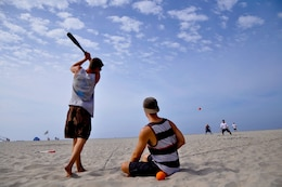"Participants from team ""New Jack City"" step up to bat during Camp Pendleton's Over-the-Line tournament at the Del Mar Beach, Sept. 22. The three players came out to the base's tournament to practice for the upcoming San Diego OTL tournament that attracts more than 1,200 teams."