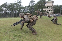Marines from Marine Corps Base Camp Lejeune conduct a live-fire scenario exercise during the Infantry Small Unit Leader Course Sept. 19. The six-week course comprised of 17 sergeants from different units.