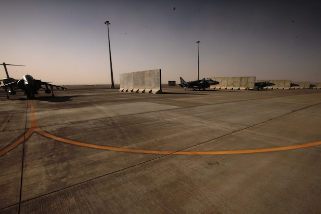 AV-8B Harriers line Camp Bastion?s airfield, Sept. 26. Despite a recent insurgent attack, which destroyed six aircraft, the squadron?s Marines know they have a job to do and intend to complete their mission and provide close-air support for Marines on the ground.