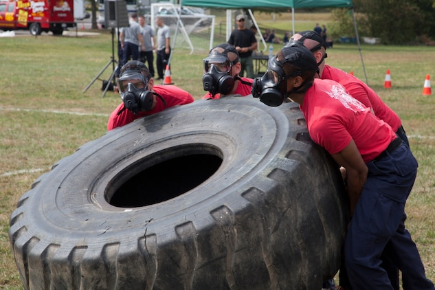 A four-man team flips a tire during the Prince George?s County Police Department?s 3rd Annual Iron Man Endurance Competition at T. Howard Duckett Park, Sept. 26.  The police department hosts the event, which is attended by teams comprised of military members, firefighters and law enforcement agencies in an effort to promote unity, physical fitness and display to the community the men and women protecting them.