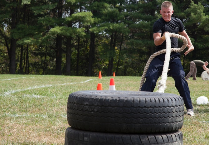 A member of the Prince George?s County Emergency Services Team competes in the tire pull, one of the last events in the 3rd Annual Iron Man Endurance Competition at T. Howard Duckett Park here, Sept. 26. The police department hosts the event, which is attended by teams comprised of military members, firefighters and law enforcement agencies in an effort to promote unity, physical fitness and display to the community the men and women protecting them.
