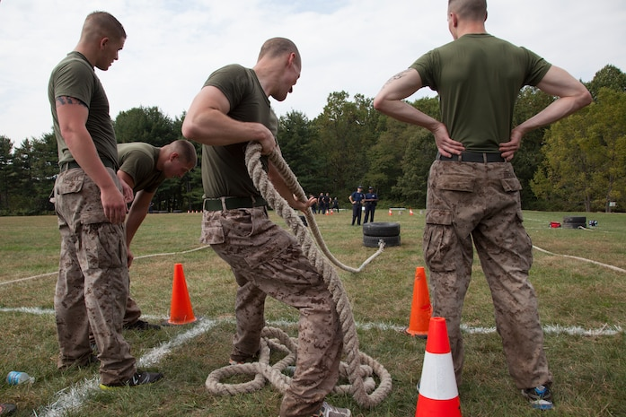 Lance Cpl. Craig Hall, a member of the silent drill platoon at Marine Barracks Washington, competes in the tire pull while his teammates rest during the 3rd Annual Iron Man Endurance Competition at T. Howard Duckett Park here, Sept. 26. The police department hosts the event, which is attended by teams comprised of military members, firefighters and law enforcement agencies in an effort to promote unity, physical fitness and display to the community the men and women protecting them.