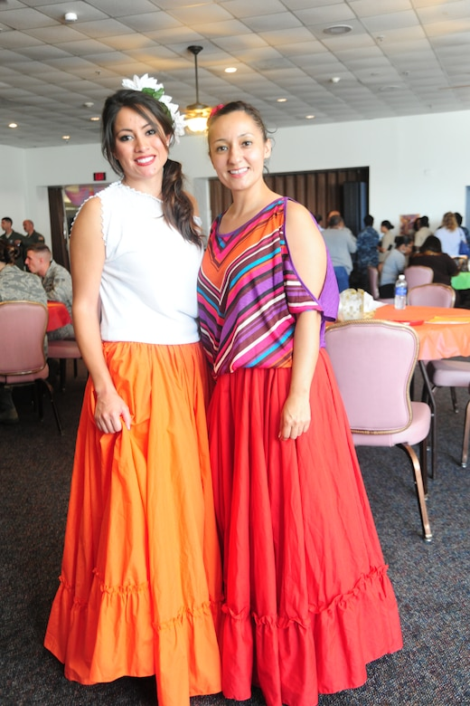 Staff Sgt. Corina Hernandez, Logistics Readiness Squadron vehicle maintenance and analysis specialist, displays Hispanic cultural attire with Master Sgt. Christina Packer, Air Force District of Washington command assistant manager, at a Hispanic-American Heritage Month celebration at the community activity center, Sept. 21, 2012. The event included a free ethnic-food tasting, a professional dancing demonstration, a live DJ and an opportunity for patrons to dance. (U.S. Air Force photo/Senior Airman Amber Russell)