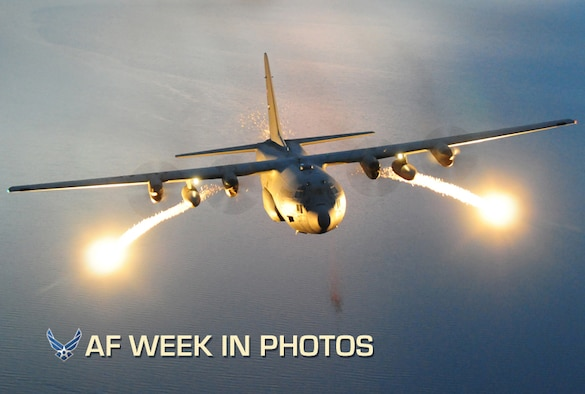 A C-130 Hercules with the 107th Airlift Wing fires off flares during a night formation training mission. Flares are used to deter infrared homing (heat seeking) surface-to-air or air-to-air missile. (U.S. Air Force photo/Senior Master Sgt. Ray Lloyd)