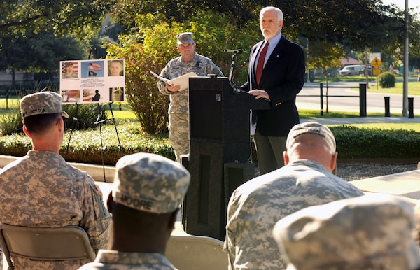Dr. Thomas McNish, a former Vietnam prisoner of war for 6 1/2 years, speaks to U.S. Army South Soldiers and civilians during a ceremony in front of the Army South headquarters Sept. 21. The National POW/MIA Recognition Day ceremony recognized and honored those who have been imprisoned and those missing while defending the nation. The ceremony concluded with the raising of the POW/MIA flag on the flagpole in front of the ARSOUTH headquarters.    Photo by St. Tamika A. Exom