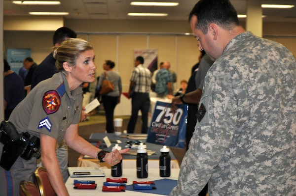 Texas Department of Public Safety Cpl. Arminda Henke meets with members of the armed forces like Sgt. 1st Class Christian Garcia at the Hiring Heroes Career Fair Sept. 18. Veterans and retirees make up 60 percent of the DPS force, according to Henke.  Photo by Deyanira Romo Rossell